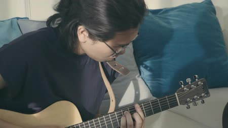 singaporean : members of a rock band rehearsing at home. Stock Footage