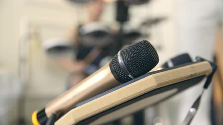 readiness : close-up shot of hands picking up microphone in a music recording studio. Stock Footage