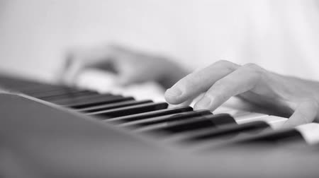 entertainers : black and white shot of a young asian musician playing keyboard. Stock Footage