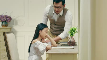 devět : nine-year-old unhappy and sad little asian girl getting comfort from father Dostupné videozáznamy
