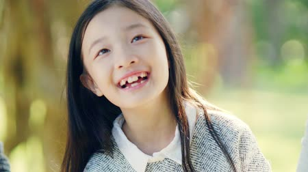 eight : close-up of little asian girl amazed at something she sees Stock Footage
