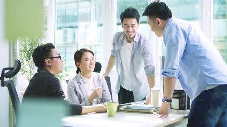 collaborating : group of young asian business people men and woman meeting discussing in office Stock Footage