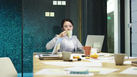 hong kong : exhausted young asian woman working overtime in office
