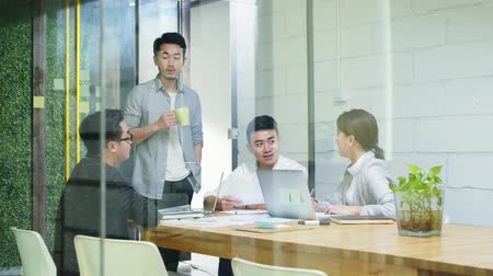 hongkonger : group of young asian entrepreneurs meeting in office discussing business plan Stock Footage