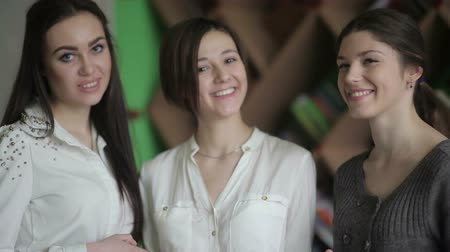 três : Three female friends smile for each other
