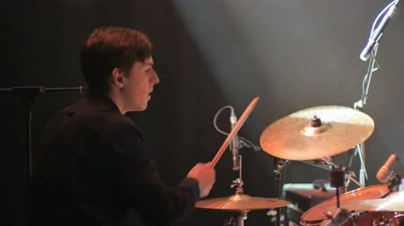 rockstar : Young drummer playing on a drums on a concert and moving to the beat music