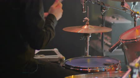 rockstar : Close-up - the drummer playing on a drum set on a concert Stock Footage