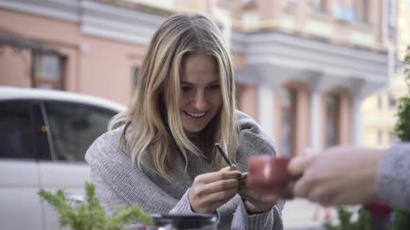 cheers : Girl in surprise looks at the spoon. Focus with a spoon. Illusionist played the girl. Stock Footage