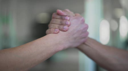 навсегда : Hands of men high five closeup. Two hands takes each other in friendly way. Two mens hands.