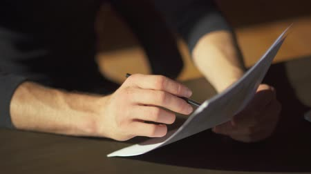 amendment : Male hands making paperwork with writing amendments in documents close up