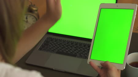 gadjet : Woman talking to person from tablet with green screen on waving hand Stock Footage