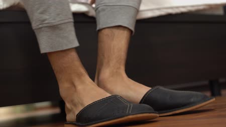 тапки : Mens legs come out from bed wear home grey slippers and walk