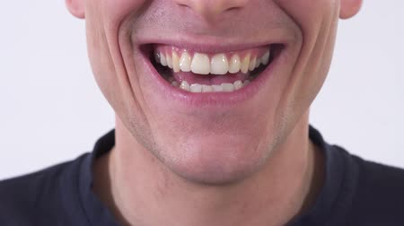 sırıtma : Close up shooting mouth of the mad man is smiling in wide unhealthy smile. Shooting in the studio on a white background