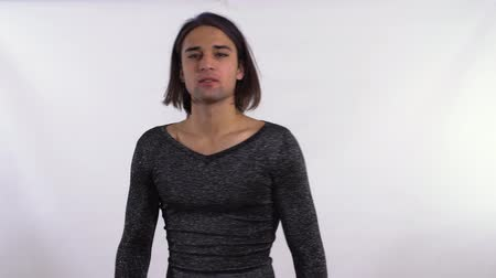 arrasto : Drag queen in a shiny blouse posing on a white background in the office. Vídeos