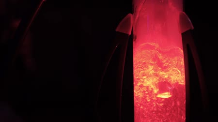 deney şişesi : Hookah mine glows in different colors close up. Leisure of shisha lovers. Club lifestyle