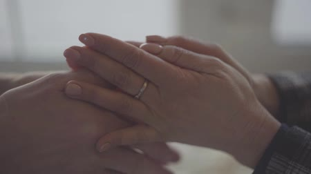 patting : Close-up of hands of a mature couple.