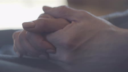patting : Closeup of hands of a mature couple.