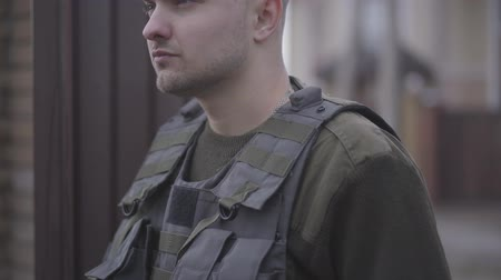 melankoli : Portrait of brave young military man going from house working to army in uniform to protect homeland Stok Video
