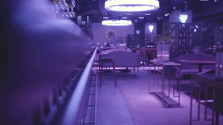 reflektor : Luxury empty night club in blue light with many comfortable armchairs and tables waiting for visitors