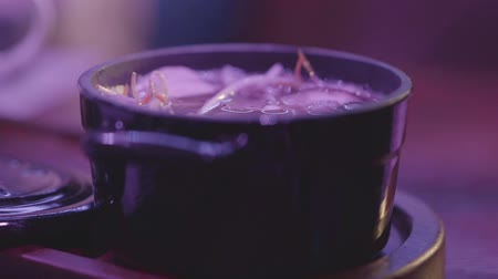 ramen : Black bowl of tasty miso soup in a black bowl with a lid on the table. Healthy food concept. Stock Footage