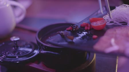 rosół : Tasty soup with mushrooms, noodles and tomato cherry in a black bowl with a lid on the table. Healthy food concept. Wideo