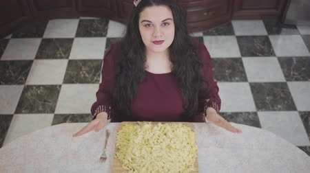 fazla : Top view of confident caucasian fat woman greedily eating too much noodles close-up. The obese lady with great appetite Stok Video