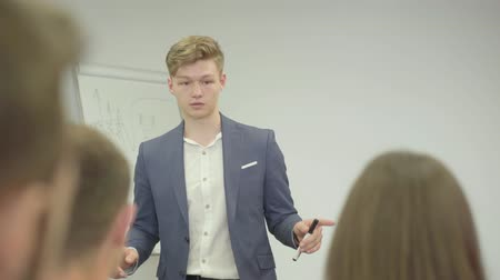 flip chart : Businessman presenting new project to partners with flip chart, team leader giving presentation to colleagues in boardroom, corporate business training. Workplace