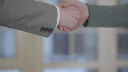 bérlet : Close-up a confident successful handshake. Successfully made a deal. Advertising and real estate agency.