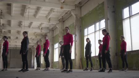 рэп : Skill dancer enjoying hip hop moves performing freestyle dance together in an abandoned building caucasian performing modern freestyle dance indoors