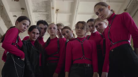 part of clip : Dance band of young girls and guys in same stage costumes emotionally showing part of performance with hands for the shooting of the video