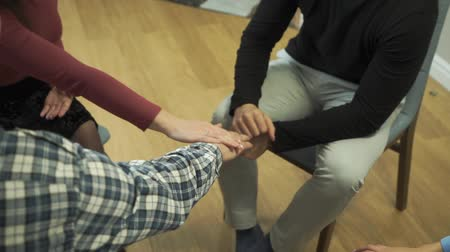 oturum : Close-up of four Caucasian hands putted on top of each other. People sitting in circle with friends. Group therapy, psychological treatment, empathy, unity