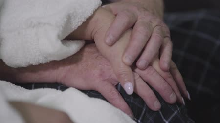 навсегда : Close-up of two pairs of senior Caucasian hands. Man caressing womans hand. Eternal love, relationship, unity, togetherness