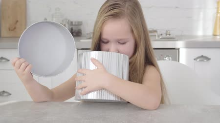 miraculous : Portrait of cute Caucasian girl looking into grey gift box. Pretty happy child holding present and smiling. Happiness, holidays season, childhood Stock Footage