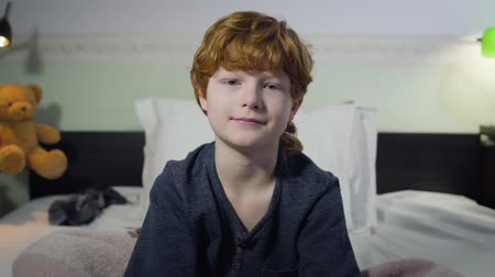 redhair : Close-up portrait of cute Caucasian boy with red hair and grey eyes looking at camera and smiling. Charming little child posing in bedroom at home. Childhood, happiness, leisure