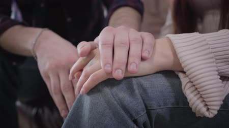 eternal : Close-up of male and female Caucasian hands holding and stroking each other. Unity and support of young couple or family. Lifestyle, care, love concept