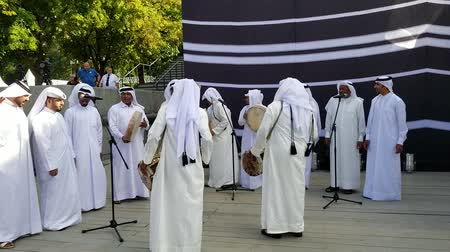 gorky : Moscow, Russia - July 2018: Group of qatari people presenting traditional music during Qatar FIFA 2022 visiting card in Gorky Park.