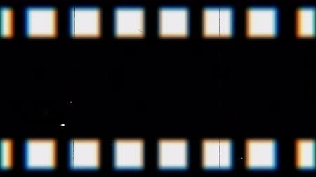videotape : Vintage looping film strip melting background. Videotape with scratches and stains. Old camera roll animation.