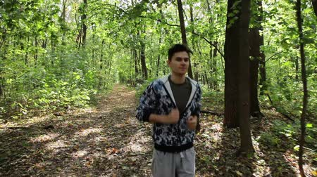 running man : young man running along path in park Stock Footage