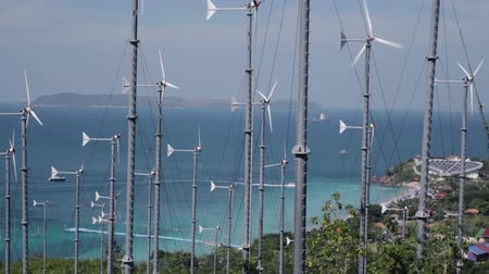 türbin : Spinning turbine blades at wind farm on the shore of Koh Larn island in Thailand Stok Video