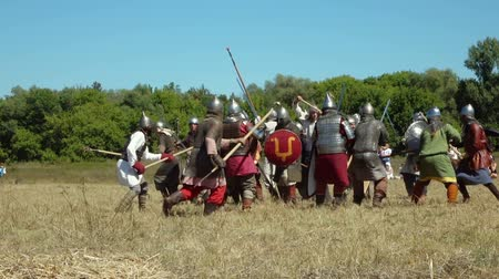 knightly : SAMARA REGION, RUSSIA - AUGUST 7: Slow motion video of Russian medieval warriors fight during international historical festival of medieval culture - 2016 on August 7, 2016 in Samara Region, Russia. Stock Footage