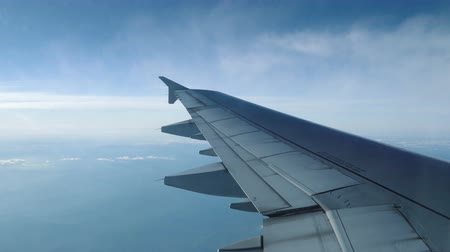 vacation : Wing of airplane flying in the sky. Airplane comes into the clouds. Stock Footage