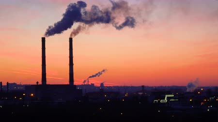 gas : timelapse video of oil refinery air pollution at sunset. 4K stock footage.