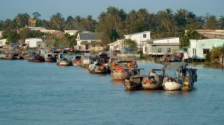 cai : CAI BE - DECEMBER 16, 2017: Heavy loaded boats arriving at the traditional floating market on Mekong delta on December 16, 2017 in Cai Be, Vietnam.