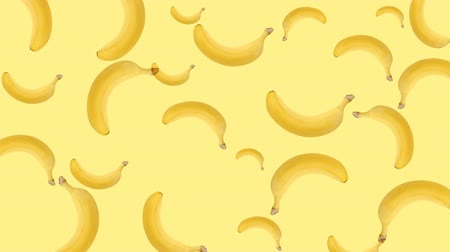 césar : Abstract colorful animation - banana color background. Bananas rotating - seamless loop ..
