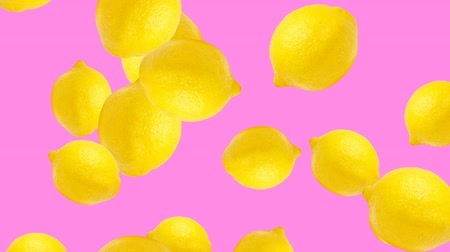 stop motion : Abstract colorful animation - Lemon color background. Lemons rolling and falling down. Stock Footage