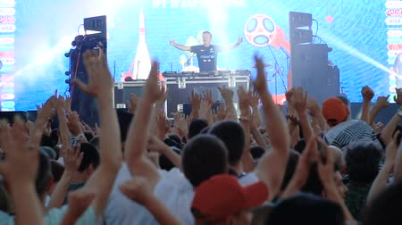 fan zone : SAMARA - JUNE 28, 2018: Football fans dancing after the game Colombia - Senegal. DJ Paul Oakenfold playing music at the official FIFA FAN FEST zone. World Cup 2018 on June 28, 2018 in Samara, Russia.