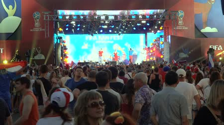 fan zone : SAMARA - JUNE 25, 2018: Football fans dancing and waving hands and flags after the game FIFA FAN FEST zone. World Cup 2018 on June 25, 2018 in Samara, Russia.