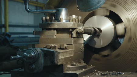 tokarka : Milling machine produces metal detail on factory. Deep field of view. Heavy industry concept video.