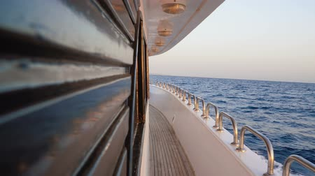 handrails : Empty yacht deck with a wooden floor of a ship which float on sea at day Stock Footage