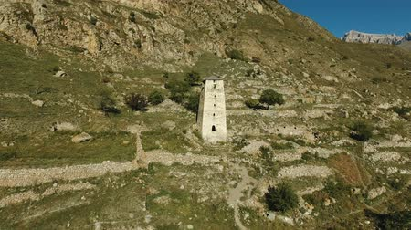 gözlem : Aerial landscape view of the Watch tower of the ancient city in the Caucasus mountains Stok Video